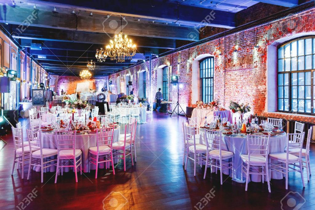 Celebration hall with tables set for banquet in loft. Vintage ro_6176